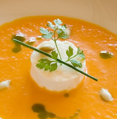 Cream of pumpkin soup with fresh Montesinos goat cheese